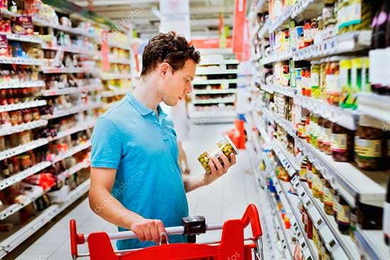 depositphotos_35847395-stock-photo-guy-chooses-groceries-in-supermarket