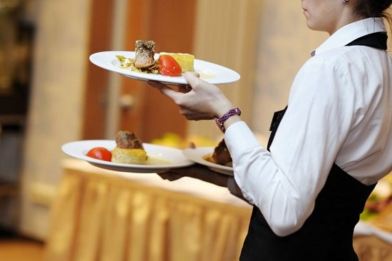 39464135 - waitress is carrying three plates with meat dish